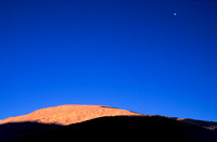 Red Rock and full moon above whiskey Mtn camp.jpg